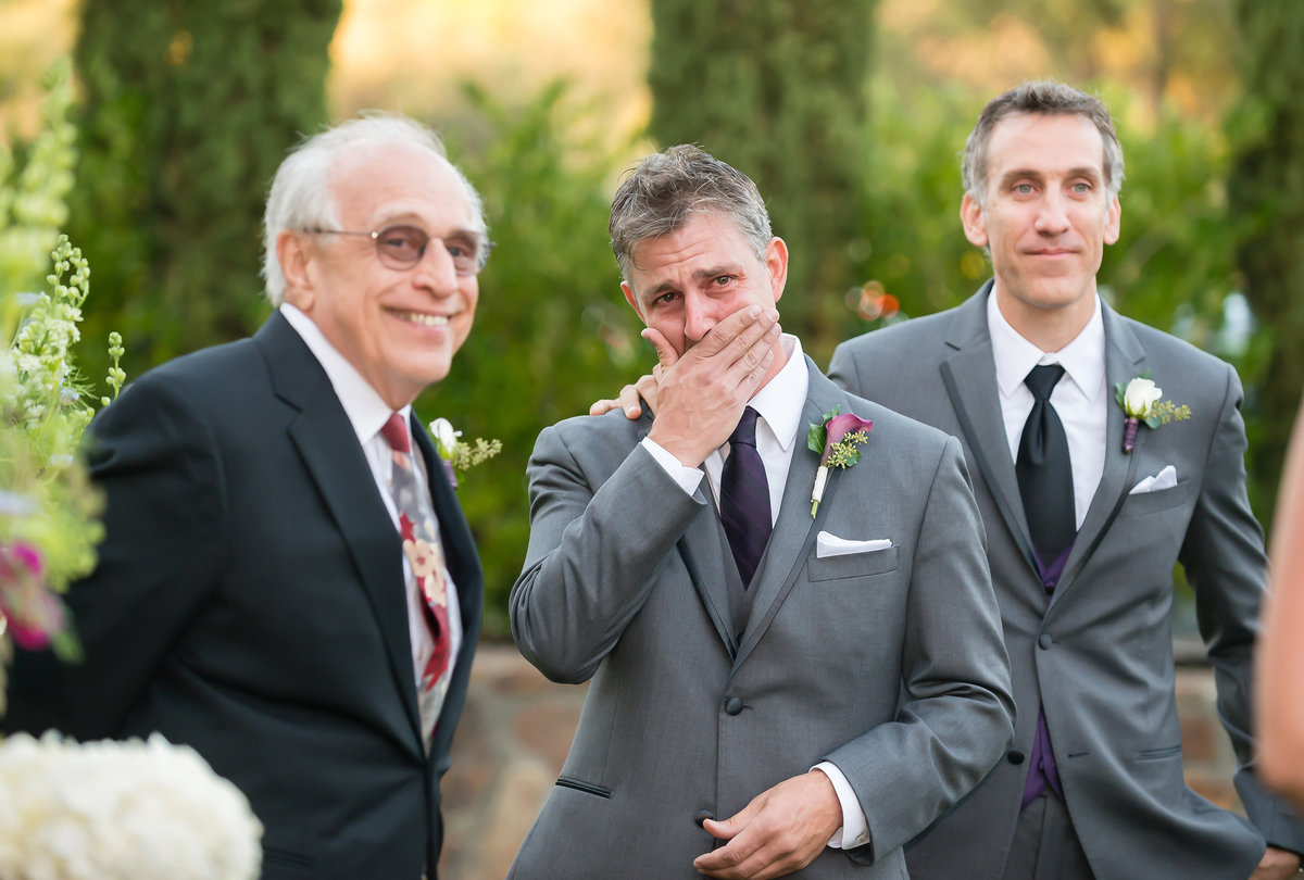 Groom cries at a vineyard wedding