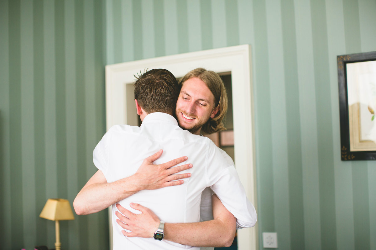 the groom hugging his brother on the morning of his wedding