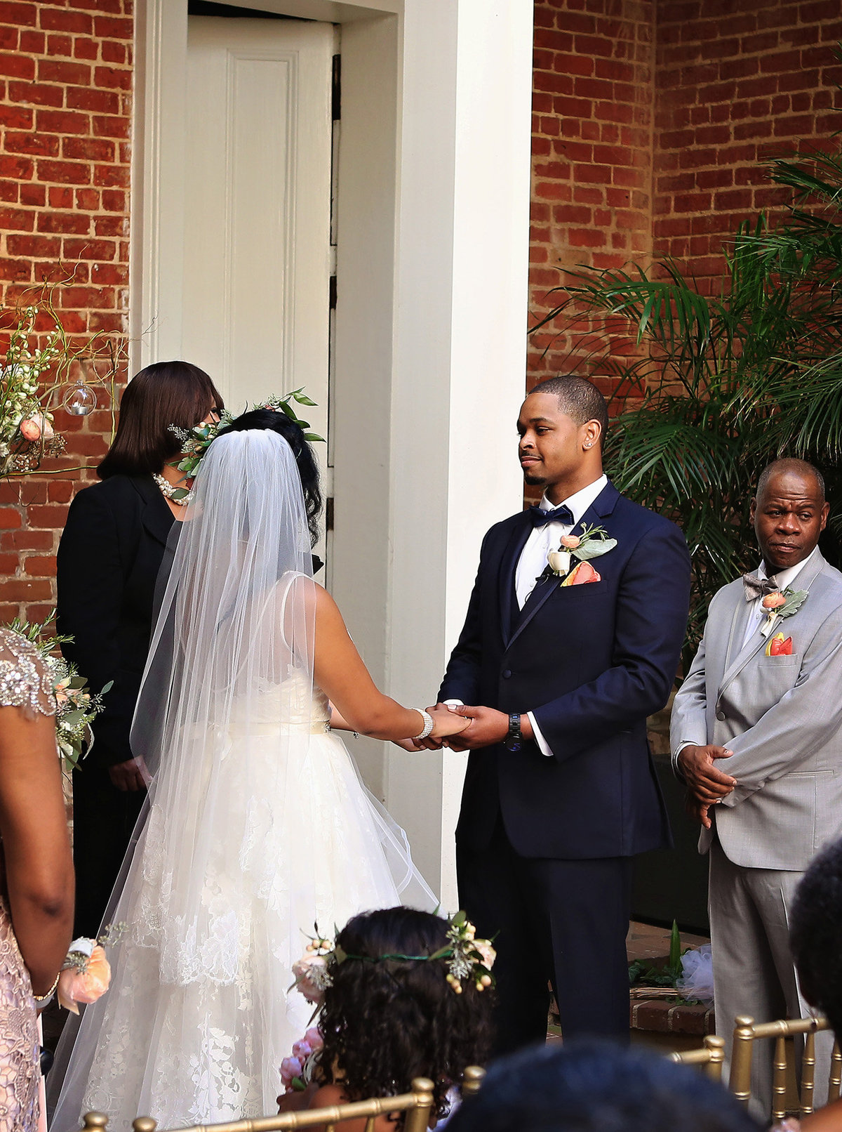 groom stares at bride on alter