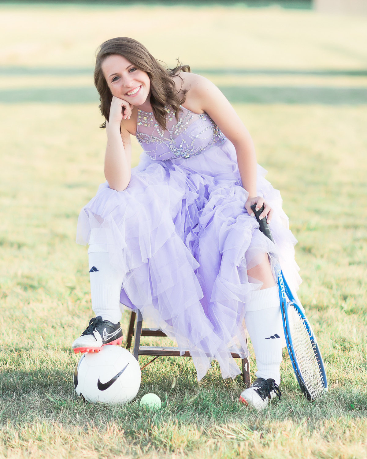 Senior girl-lavender prom dress and sports equipment-soccer and tennis