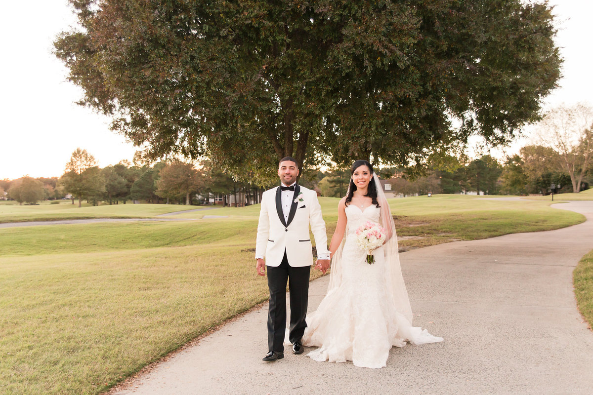 A bride and groom pose at The Dominion Club in Richmond