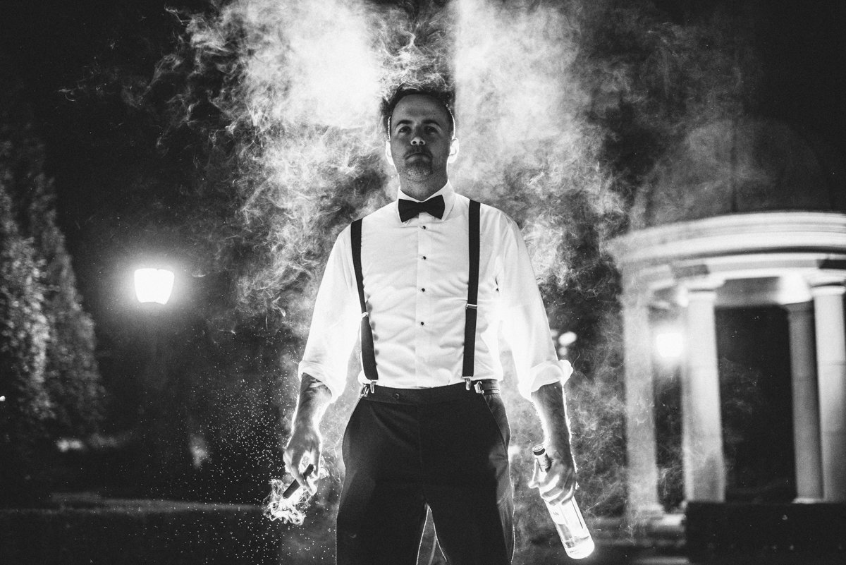 wedding reception black and white dramatic smoke cigar shot groom groomsmen night shot