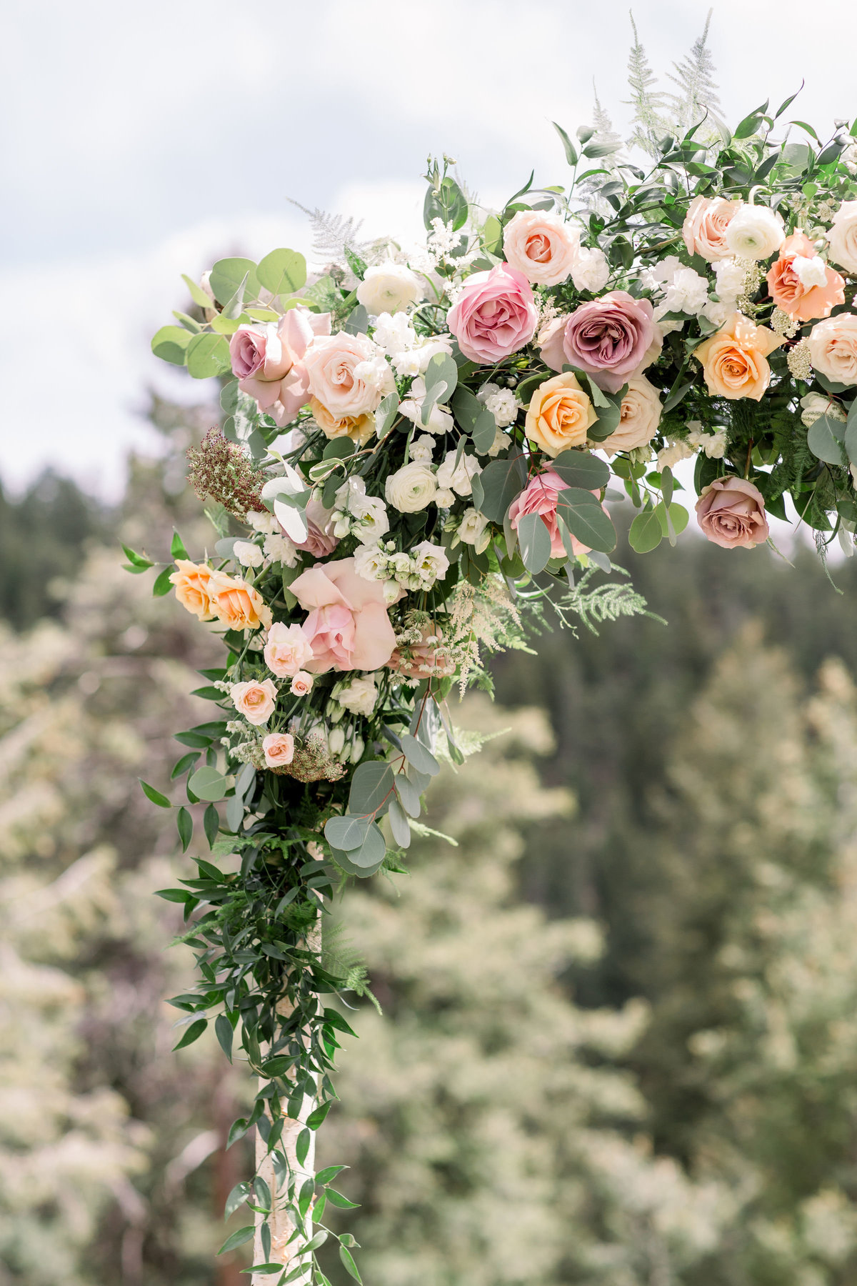 Detail of floral wedding arch, wedding ceremony in Denver