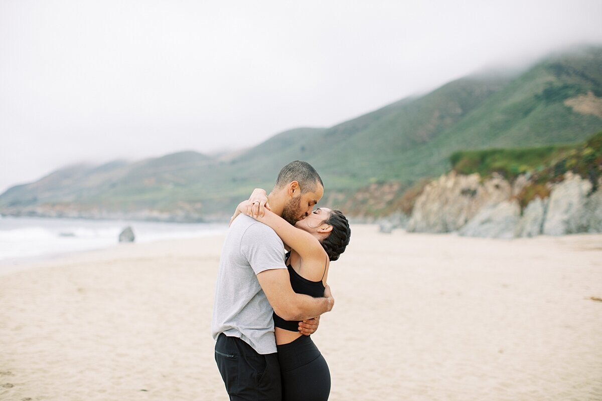 Couple kisses along the big sur coast