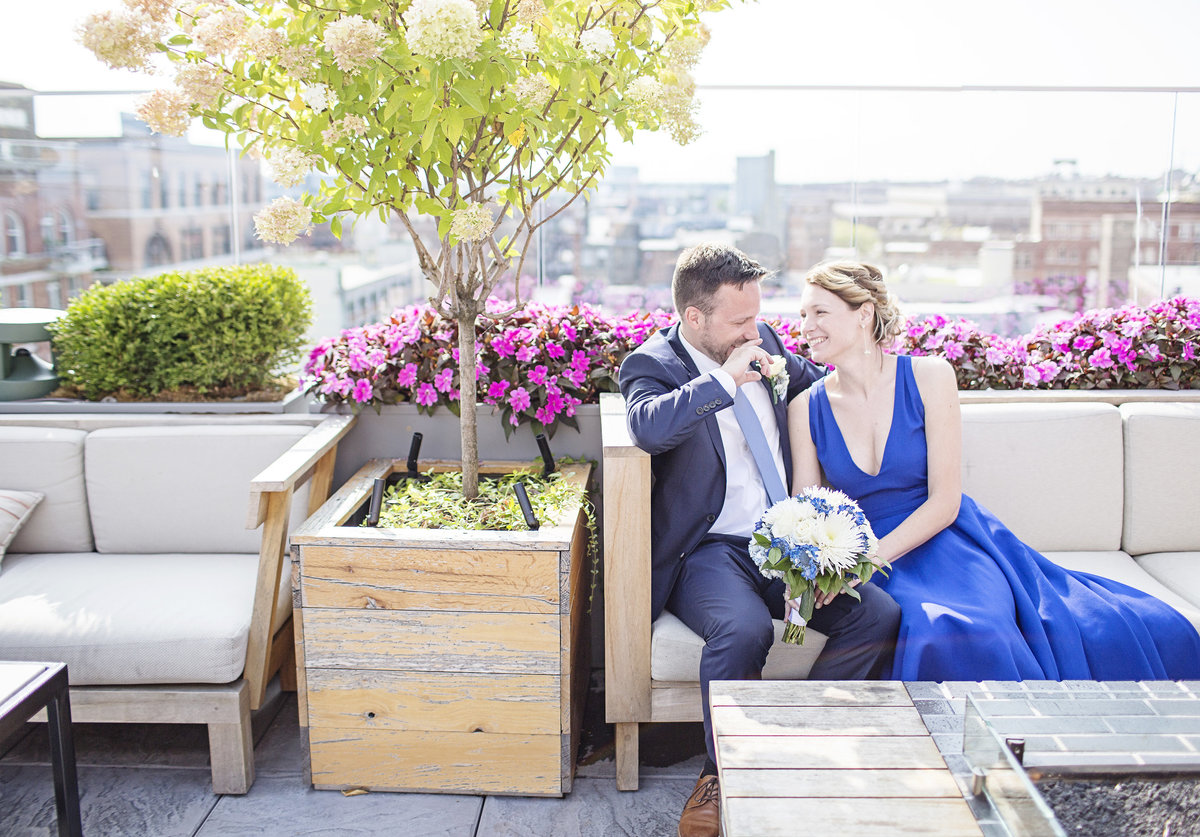colorful elopement wedding bride in blue dress rooftop in Milwaukee Wisconsin