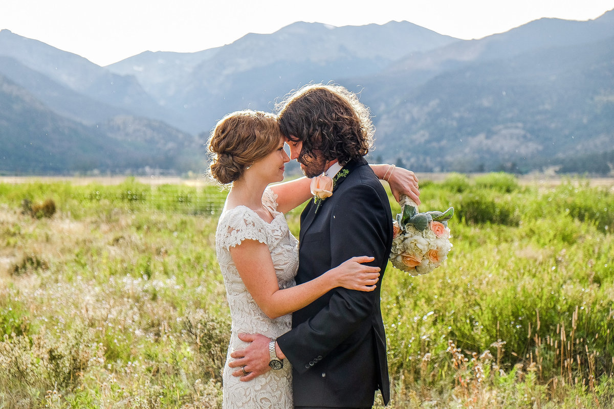 Romantic embrace between bride and groom, Denver wedding photographer