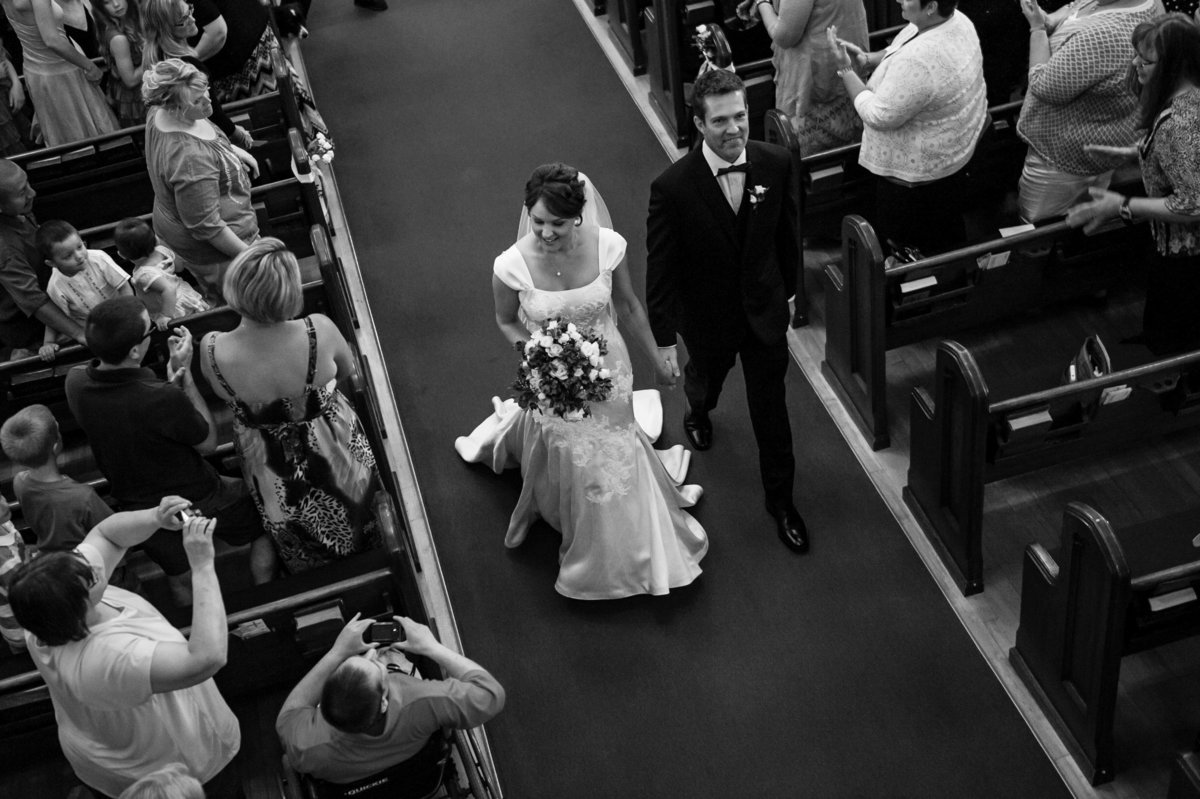 aerial shot from balcony couple in aisle