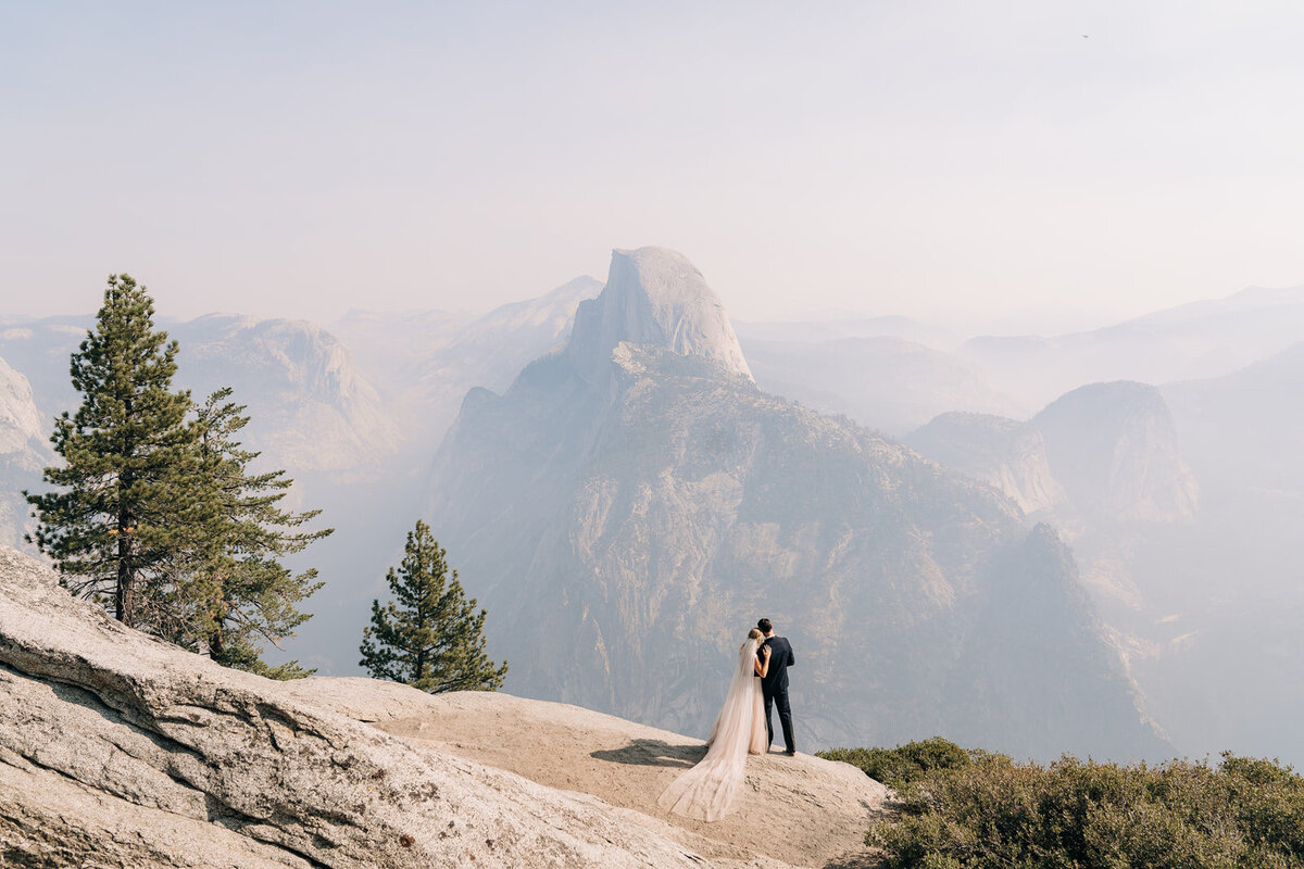 Bride and groom hugging in Yosemite