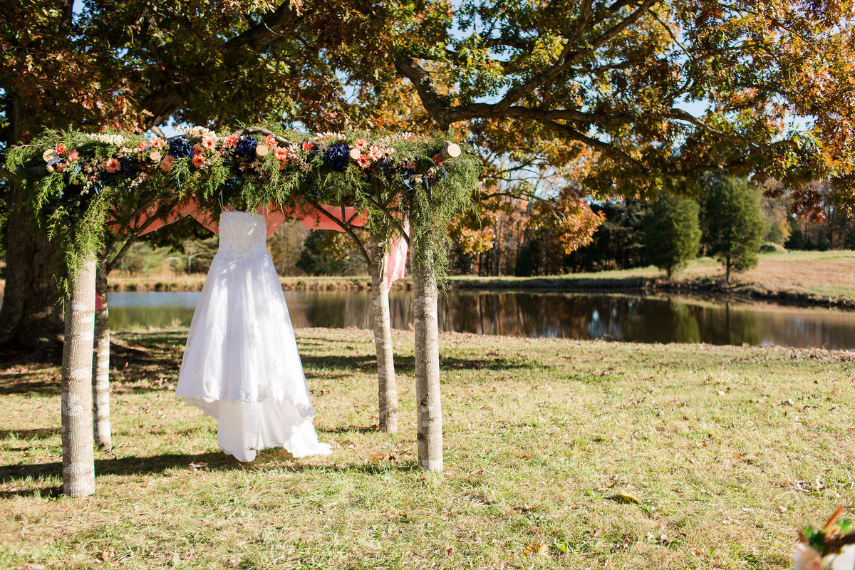 A dress hangs from a decorated arbor at Forest Green Shooting Preserve in Spotsylvania