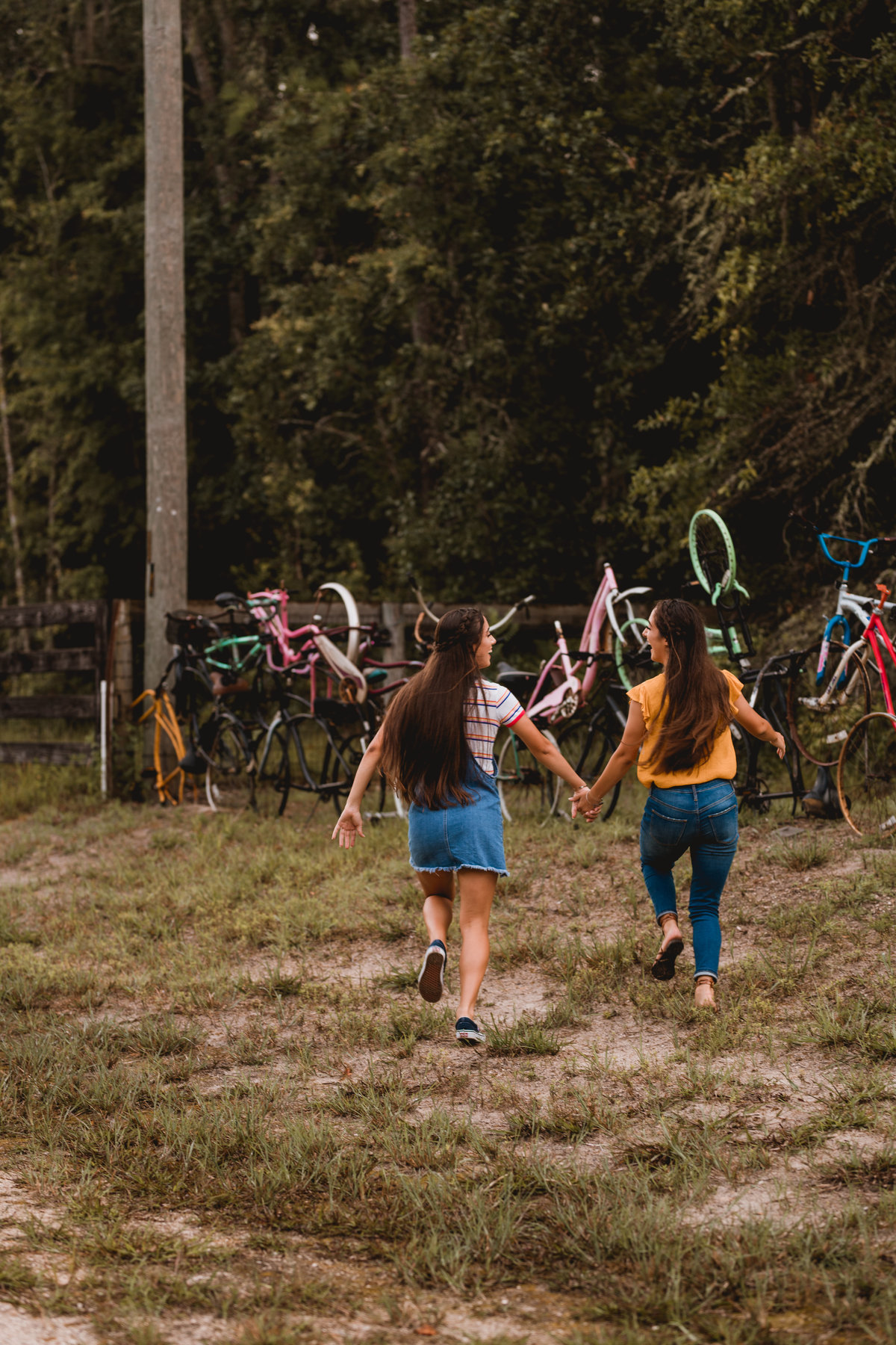 Twin senior girls have fun, interaction photography session in North Florida.