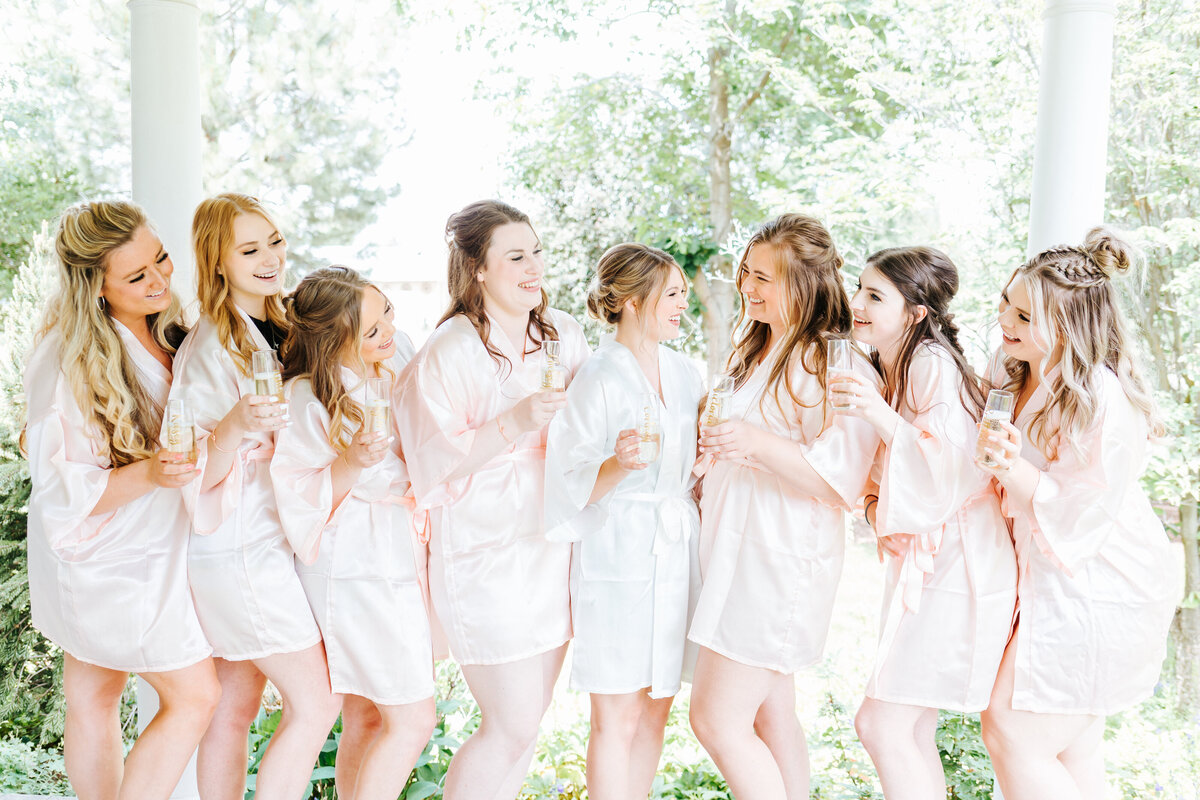 Bridesmaids in Robes with Mimosas at Fourth Street Gardens Wedding