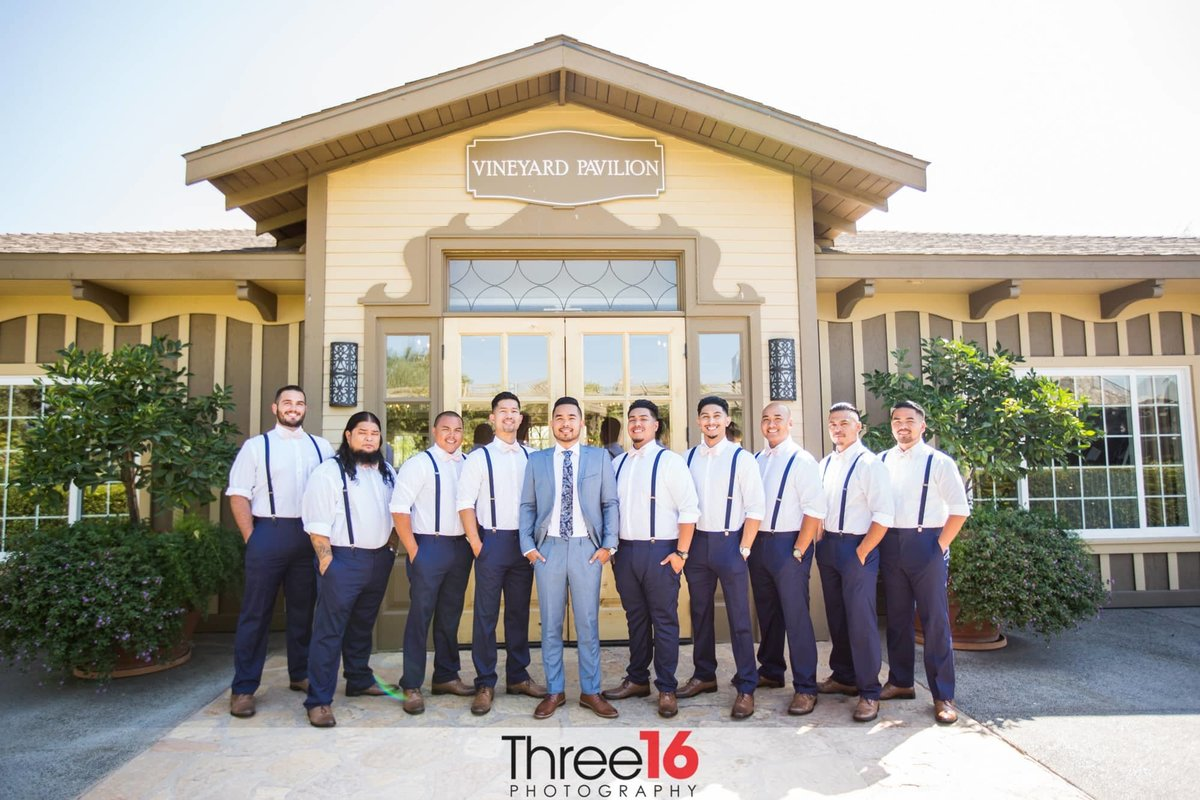 Groom poses with his Groomsmen