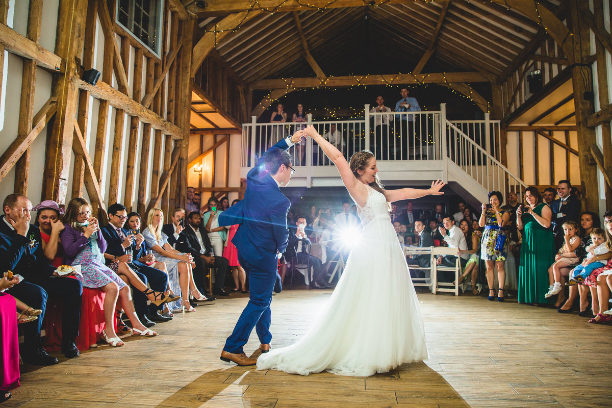 bride and groom first dance in milling wedding barn