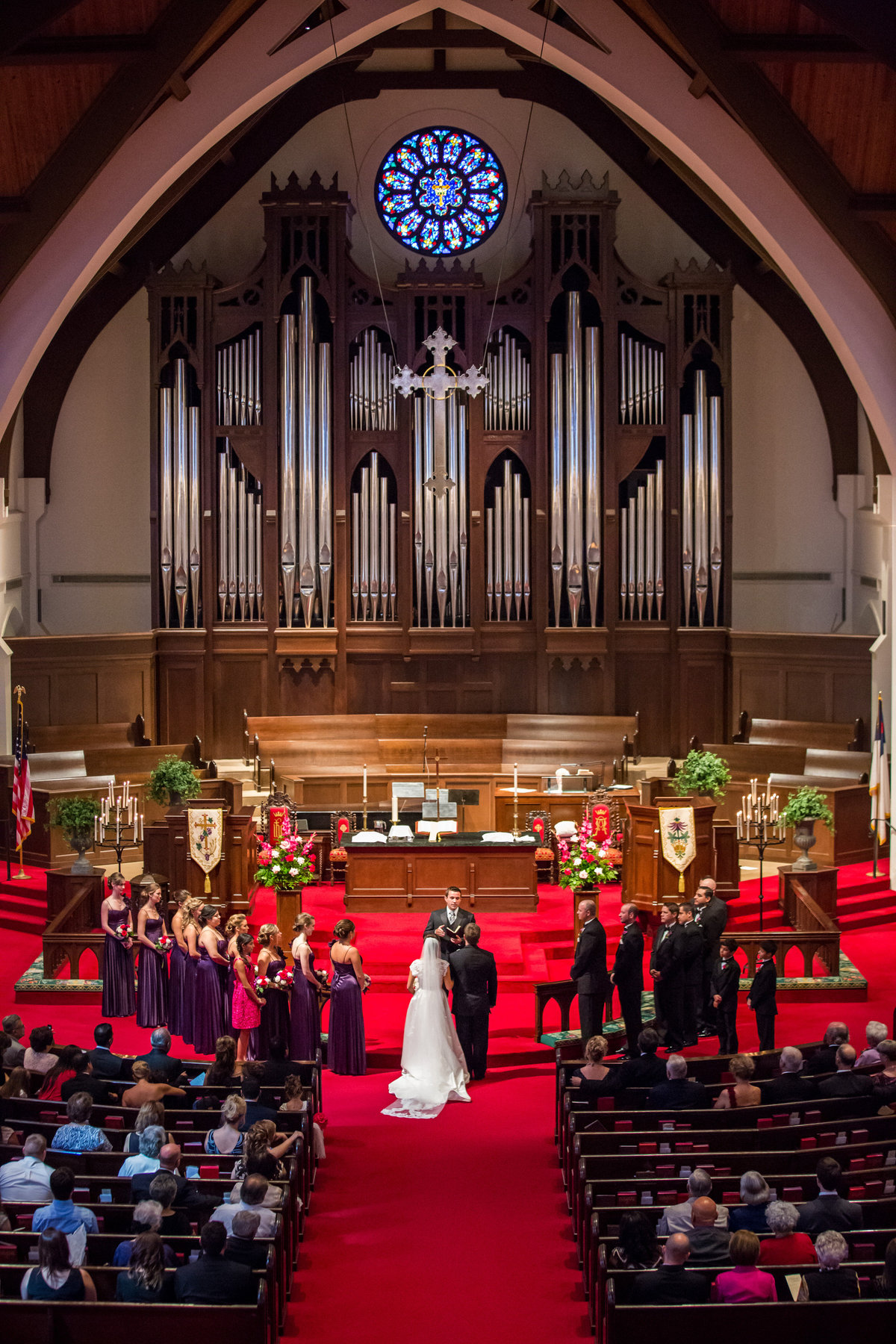 bride groom and bridal party stand at altar during wedding ceremony at Alamo Heights United Methodist Church in San Antonio