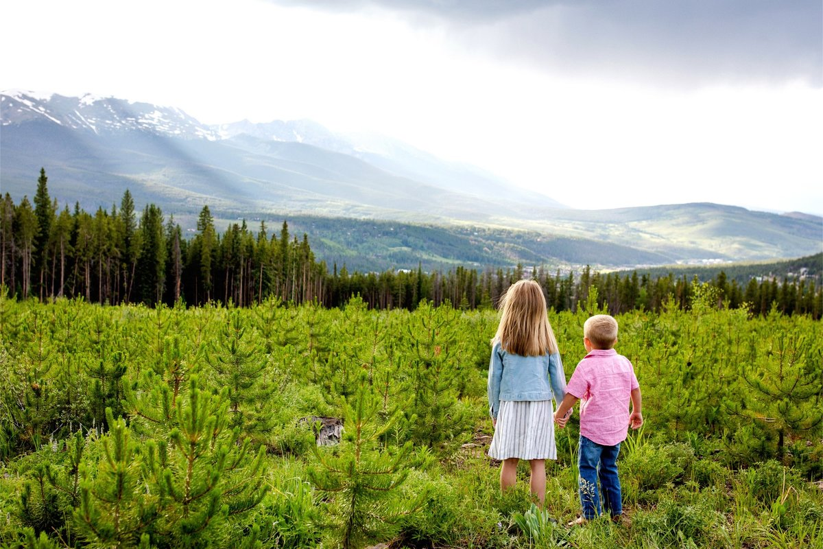 Little boy and girl playing in the Colorado mountains