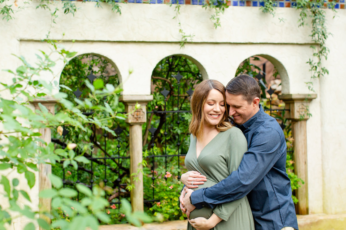 Winter Sunset Maternity Session with green maxi dress  at Missouri Botanical Garden in St. Louis by Amy Britton Photography Photographer  in St. Louis