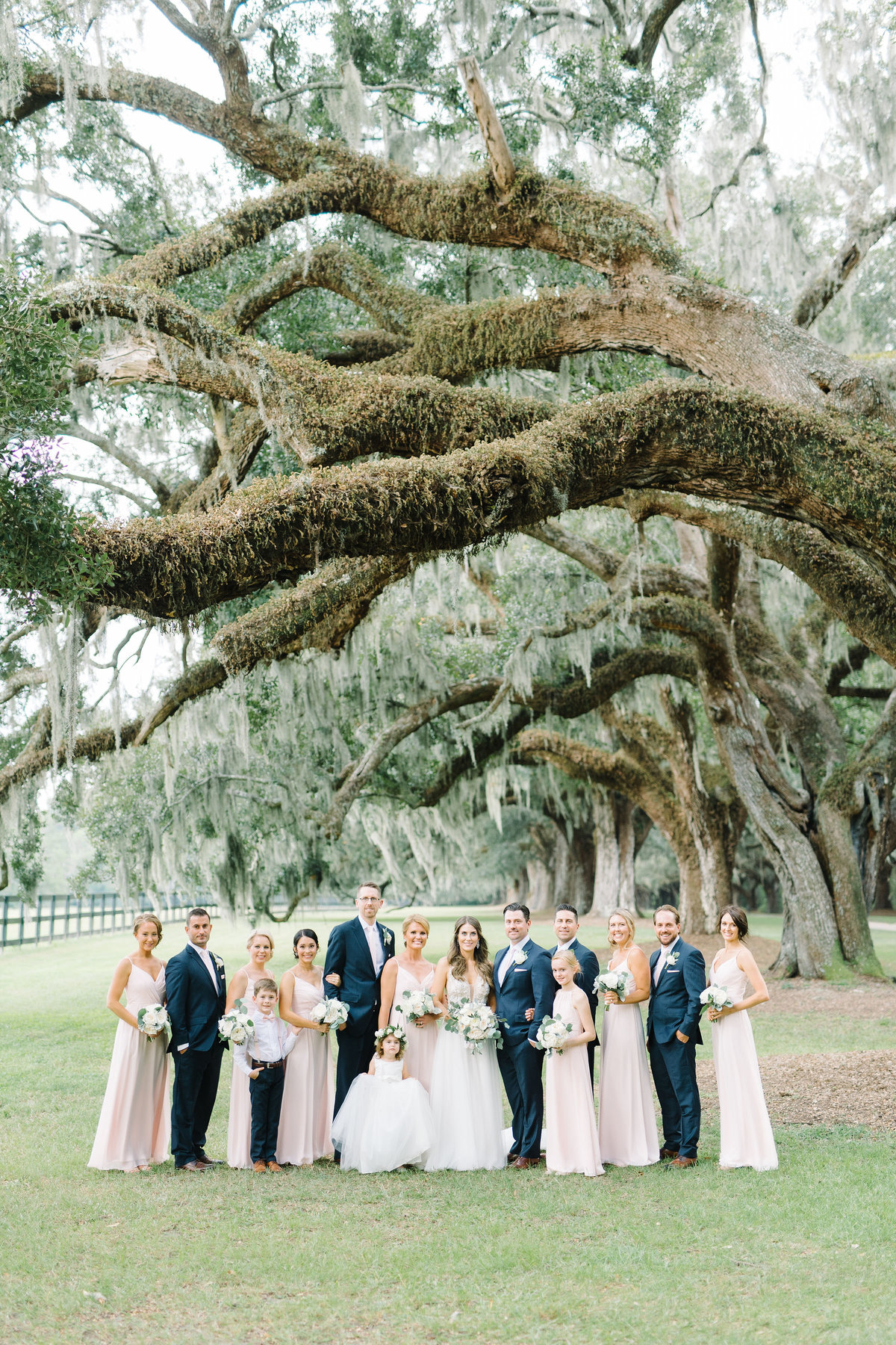 Wedding Party at Boone Hall Plantation Bridesmaids in Blush Pink Dresses and Groomsmen in Navy Blue Suits