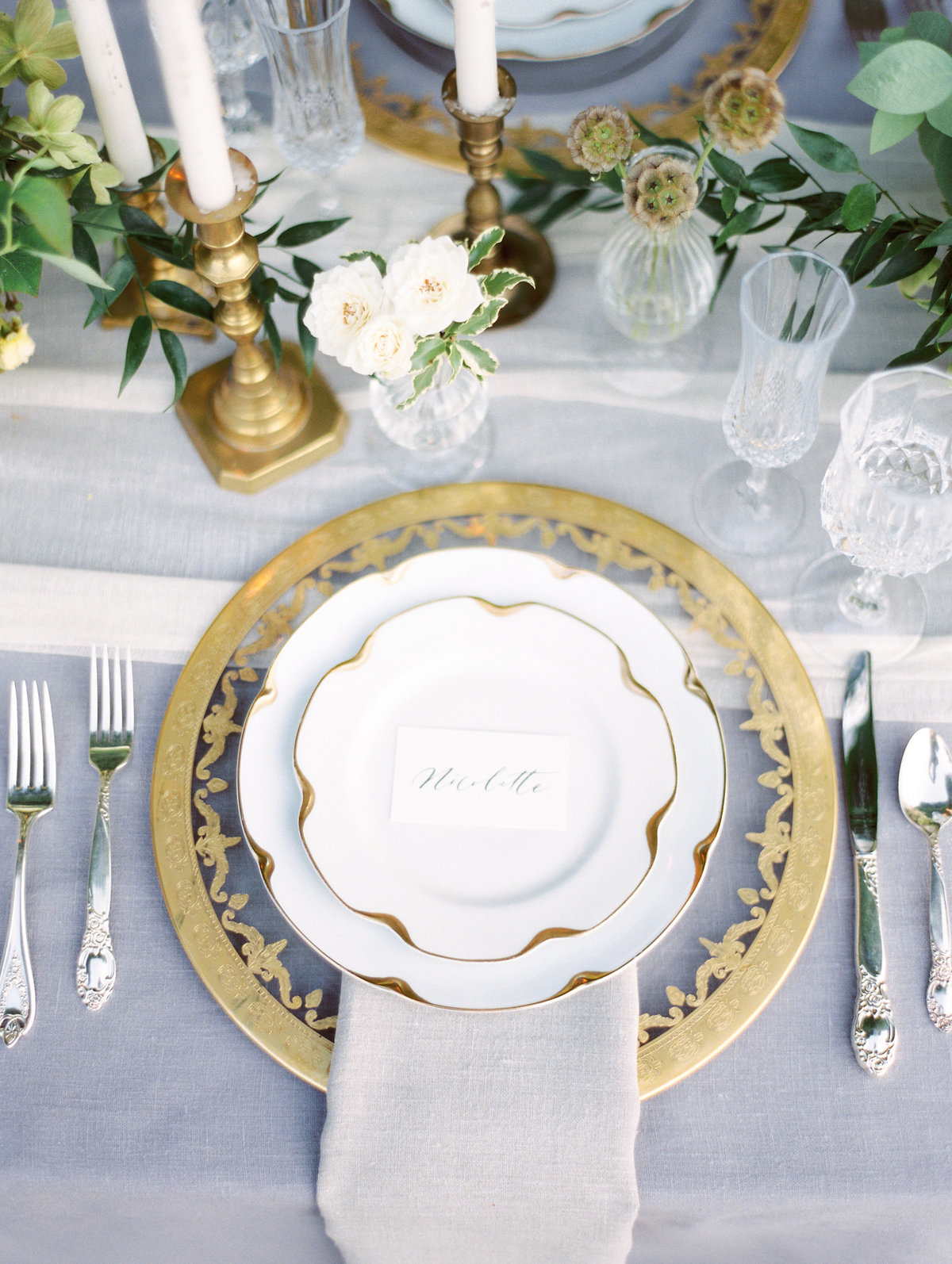 gold place setting at a wedding at monet vineyards
