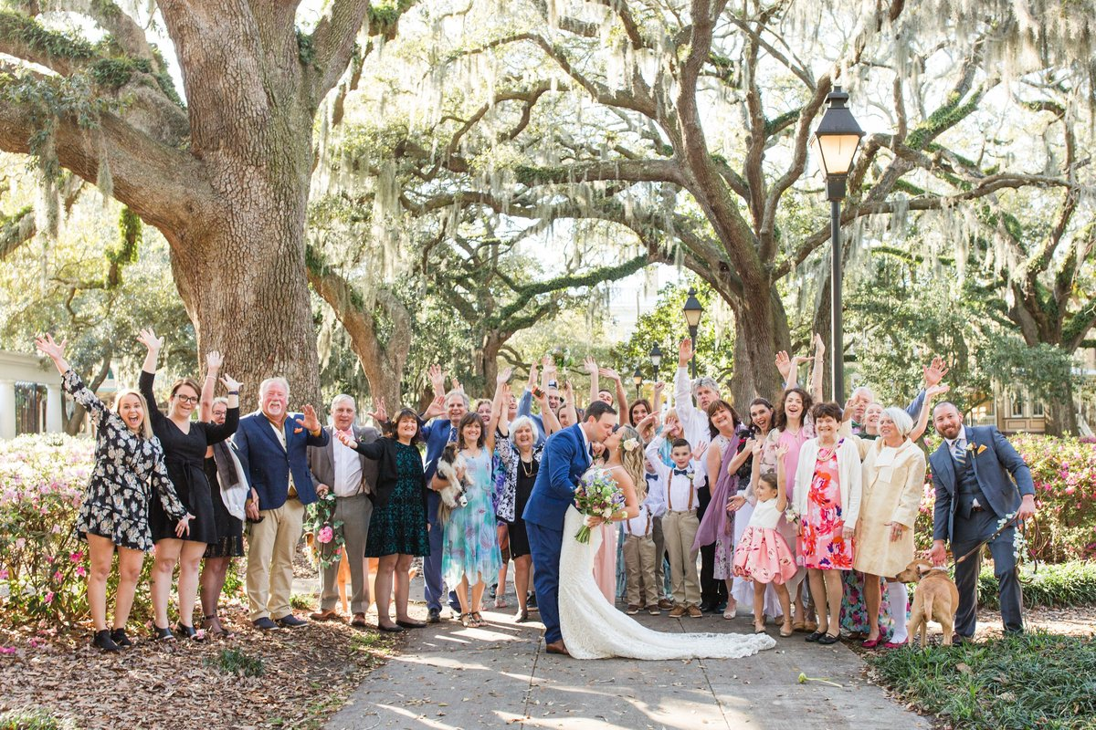 whole family at wedding  in forsyth park