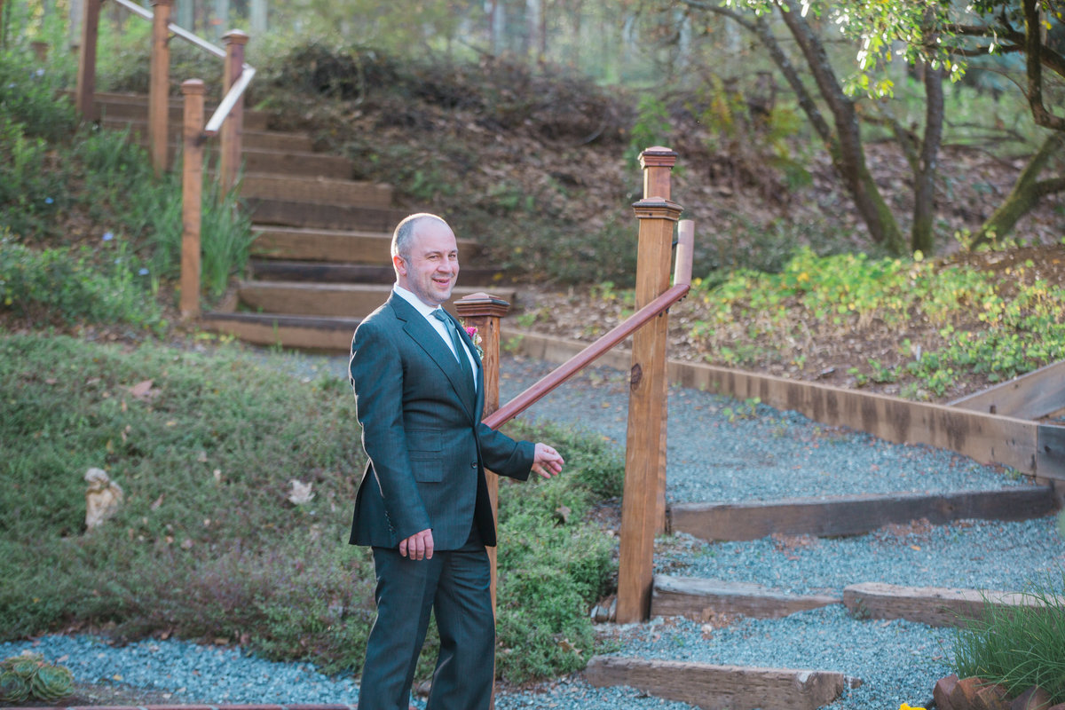 Groom outside waiting for first look at Madrona Manor in Healdsburg California