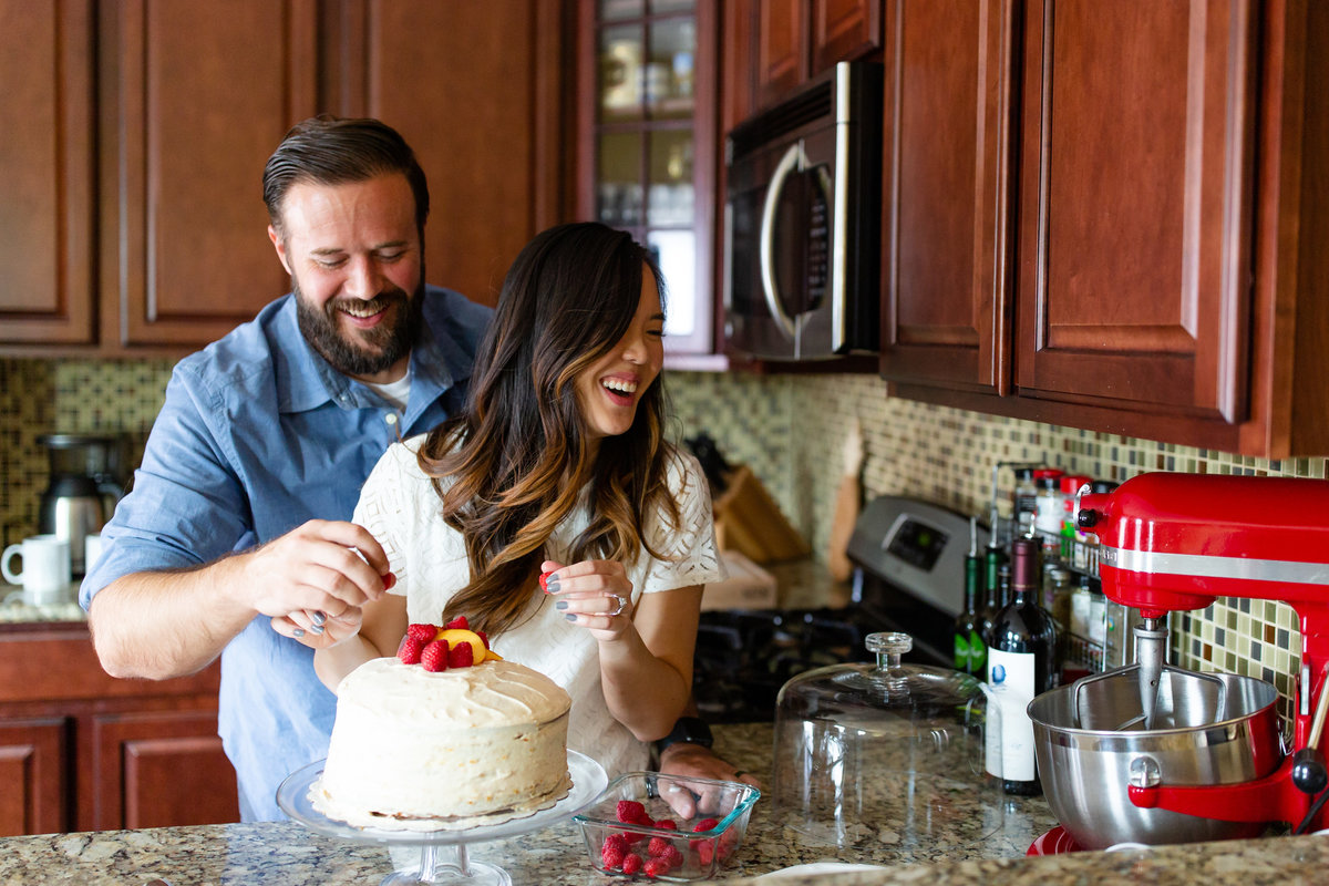 Romantic In Home Lifestyle Couple's  Session laughing  decorating cake in kitchen in St. Louis by Amy Britton Photography Photographer  in St. Louis