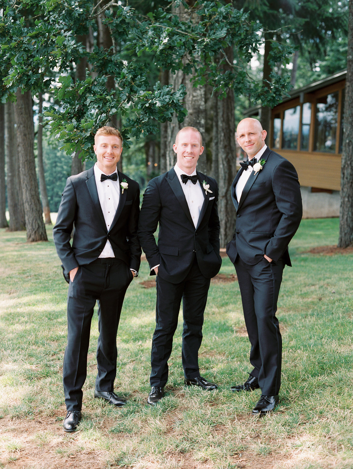 groomsmen standing in front of vista hills tasting room