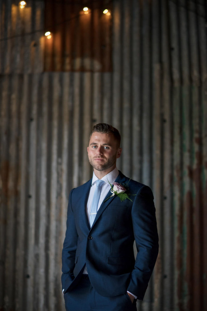 Groom in the rustic barn at The Green Cornwall