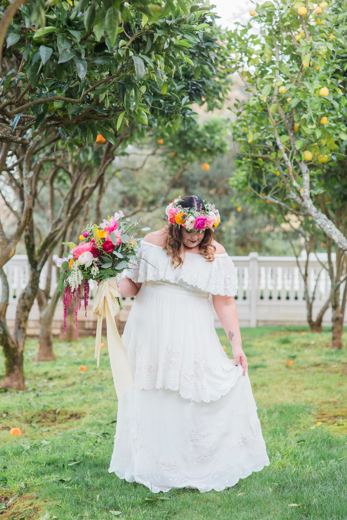 Bride show off boho dress in grove of trees Bride and groom joining cocktail hour at Madrona Manor in Healdsburg California.jpg