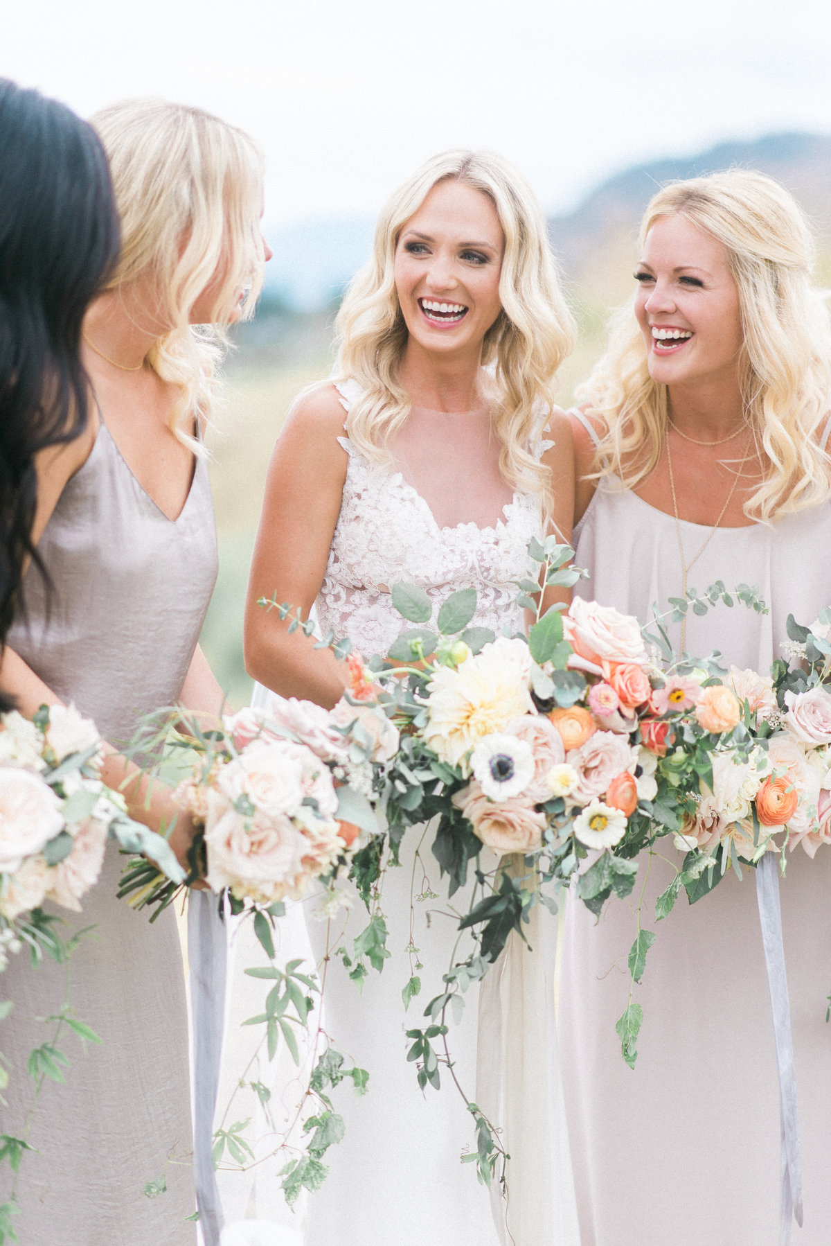 bride holding bouquet with bridesmaids