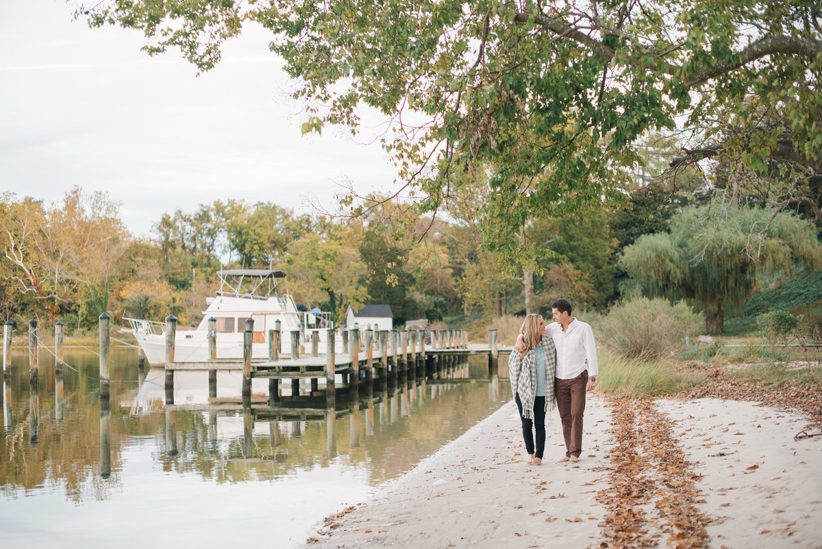 A couple walking along a river in Southern Maryland