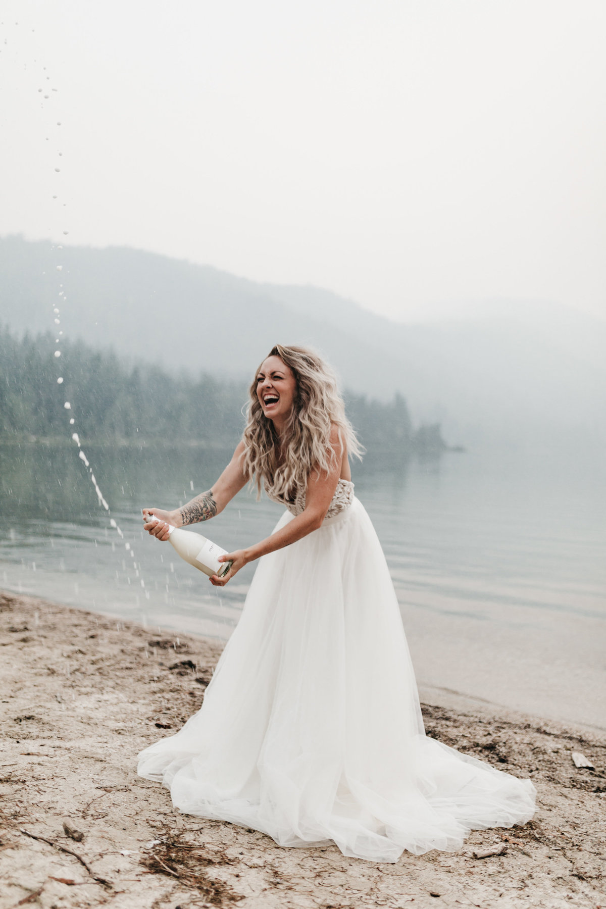 athena-and-camron-sara-truvelle-bridal-wenatchee-elopement-intimate-29-champagne-pop-bride