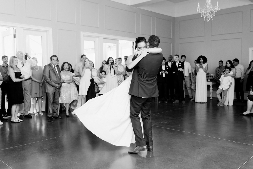 bride and groom first dance spinning
