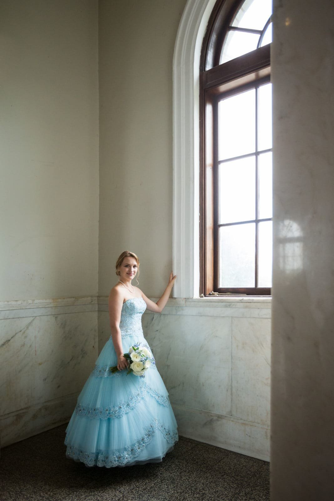 bridal portrait by window at Atlanta Historic Dekalb Courthouse wedding