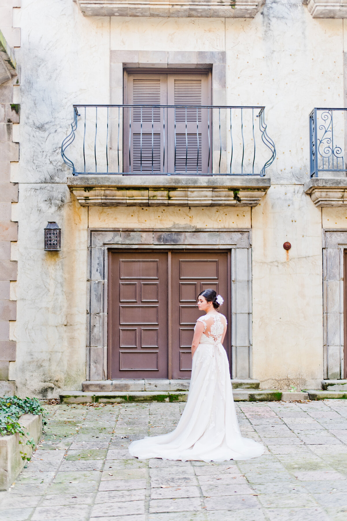 Bride standing in front of Fort Worth wedding venue