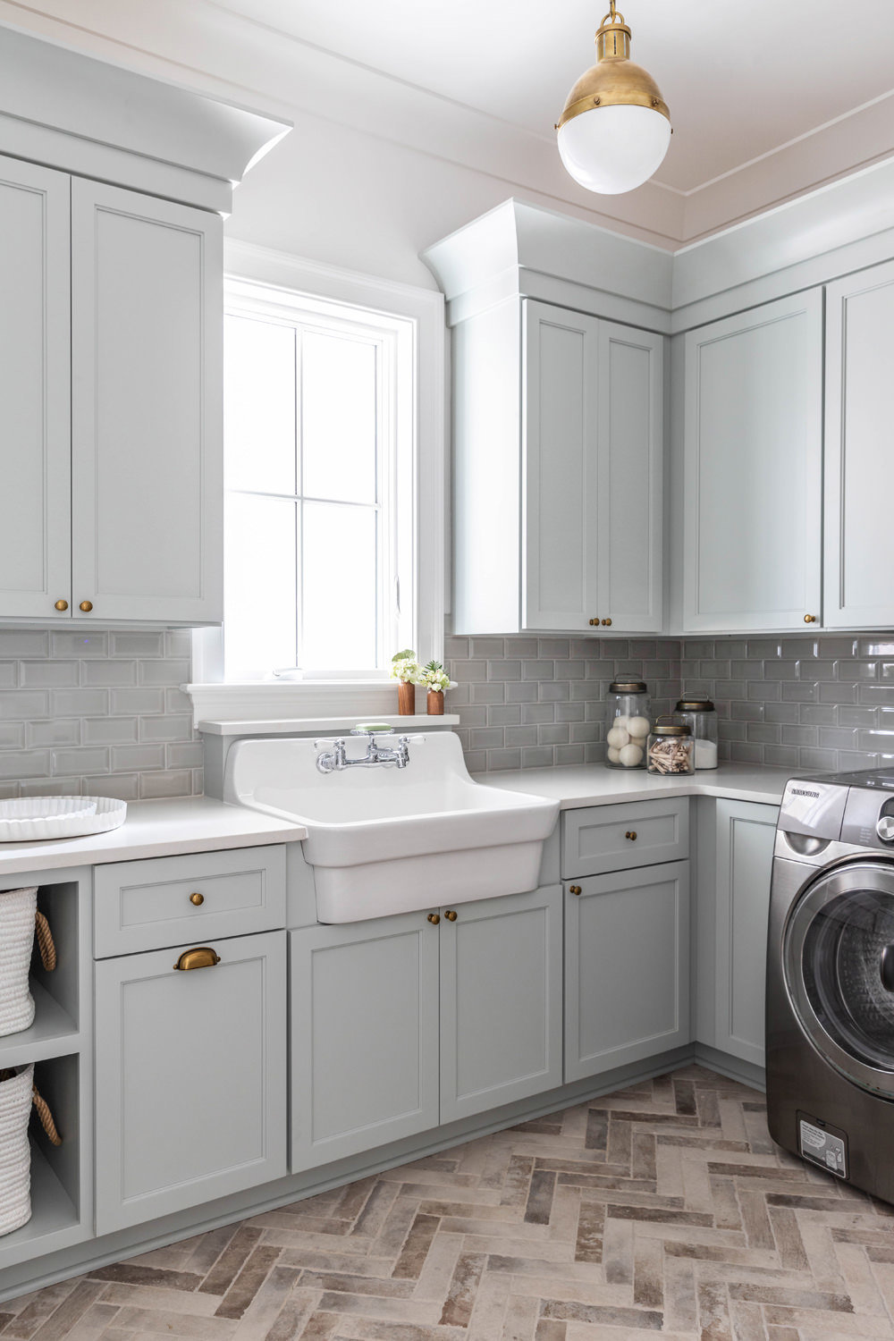Sherwin-Williams-Silver-Strand-Laundry-Room-with-Kohler-Utility-Sink-and-Brick-Herringbone-Floor-1