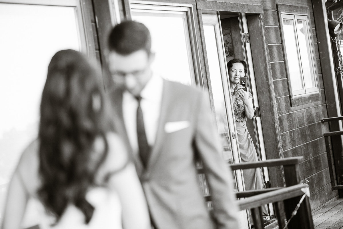 A couple sees each other for their first time at their wedding at Thomas Fogarty Winery.