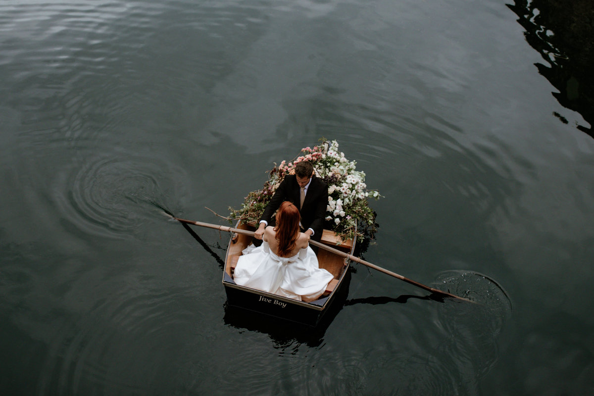Bride and Groom on Boat with Flowers at Euridge Manor