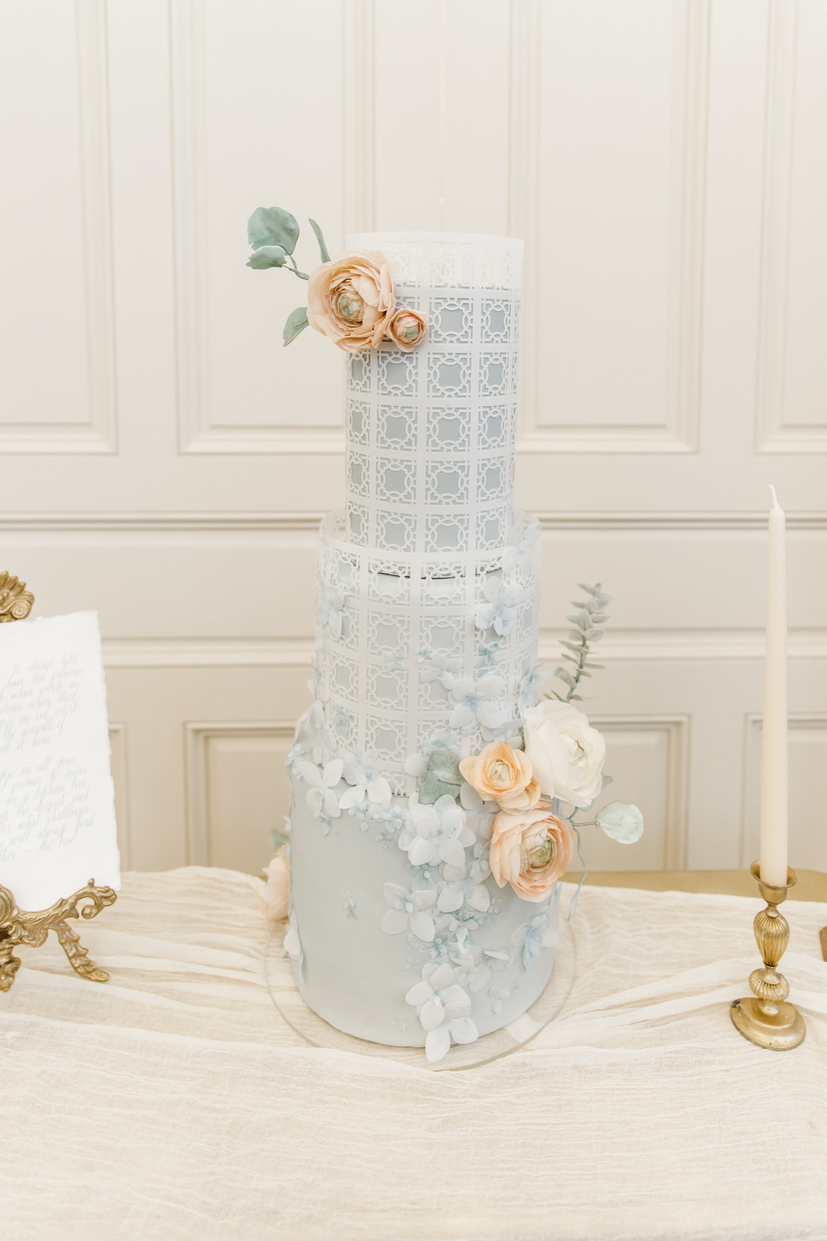 Light Blue 3 tier cake with white flowers at The Olana