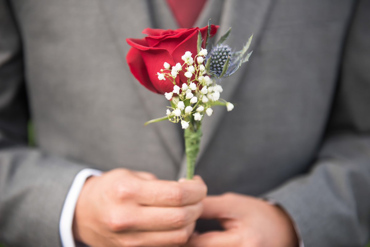 man with flower on wedding day