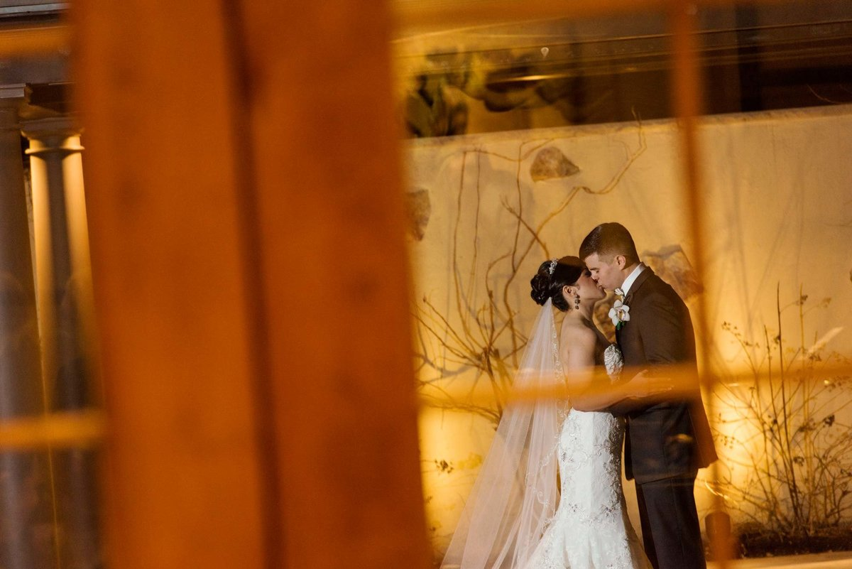 Bride and groom kissing outside Larkfield Manor