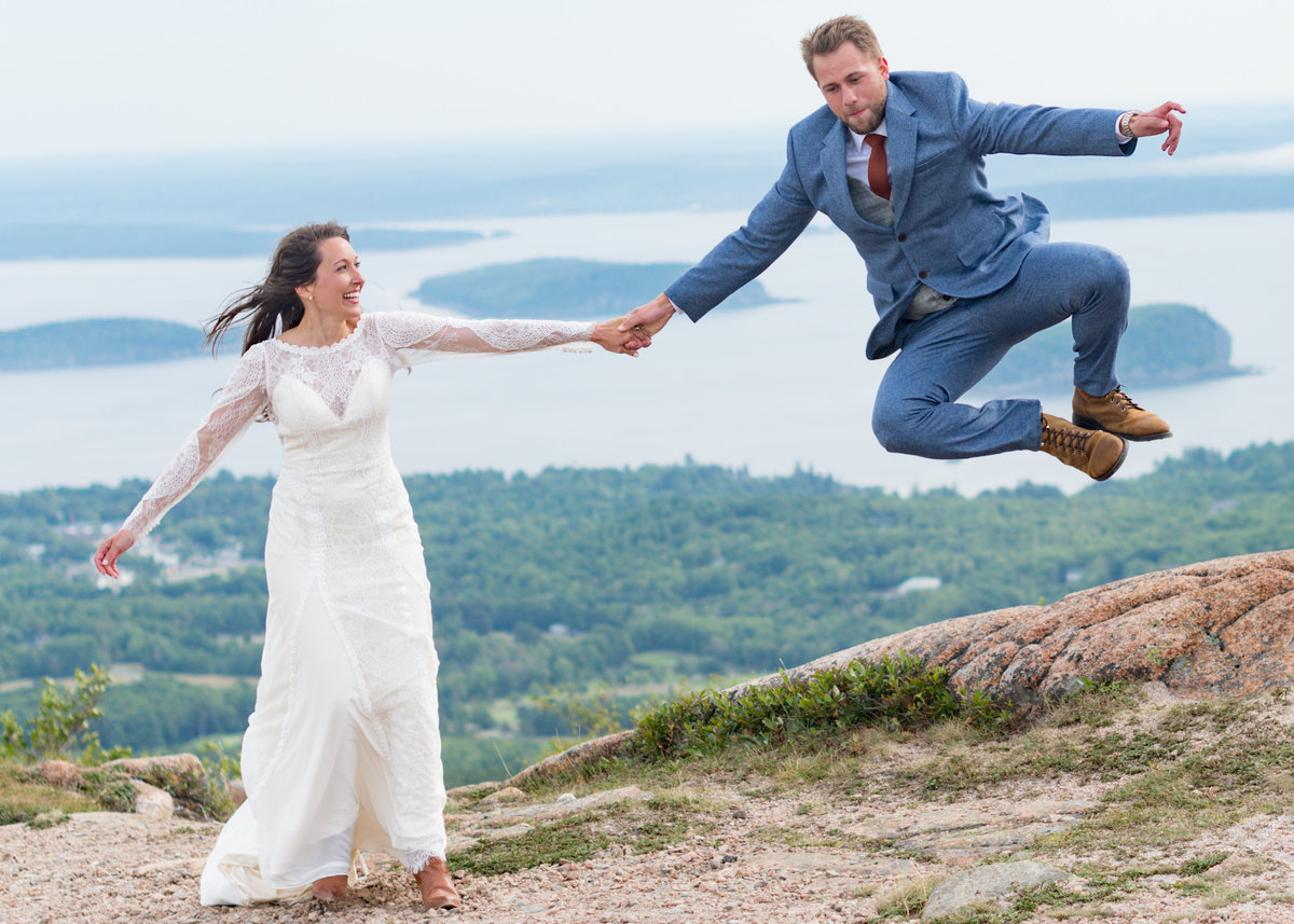 Couple jumps for joy in Acadia National Park during their elopement