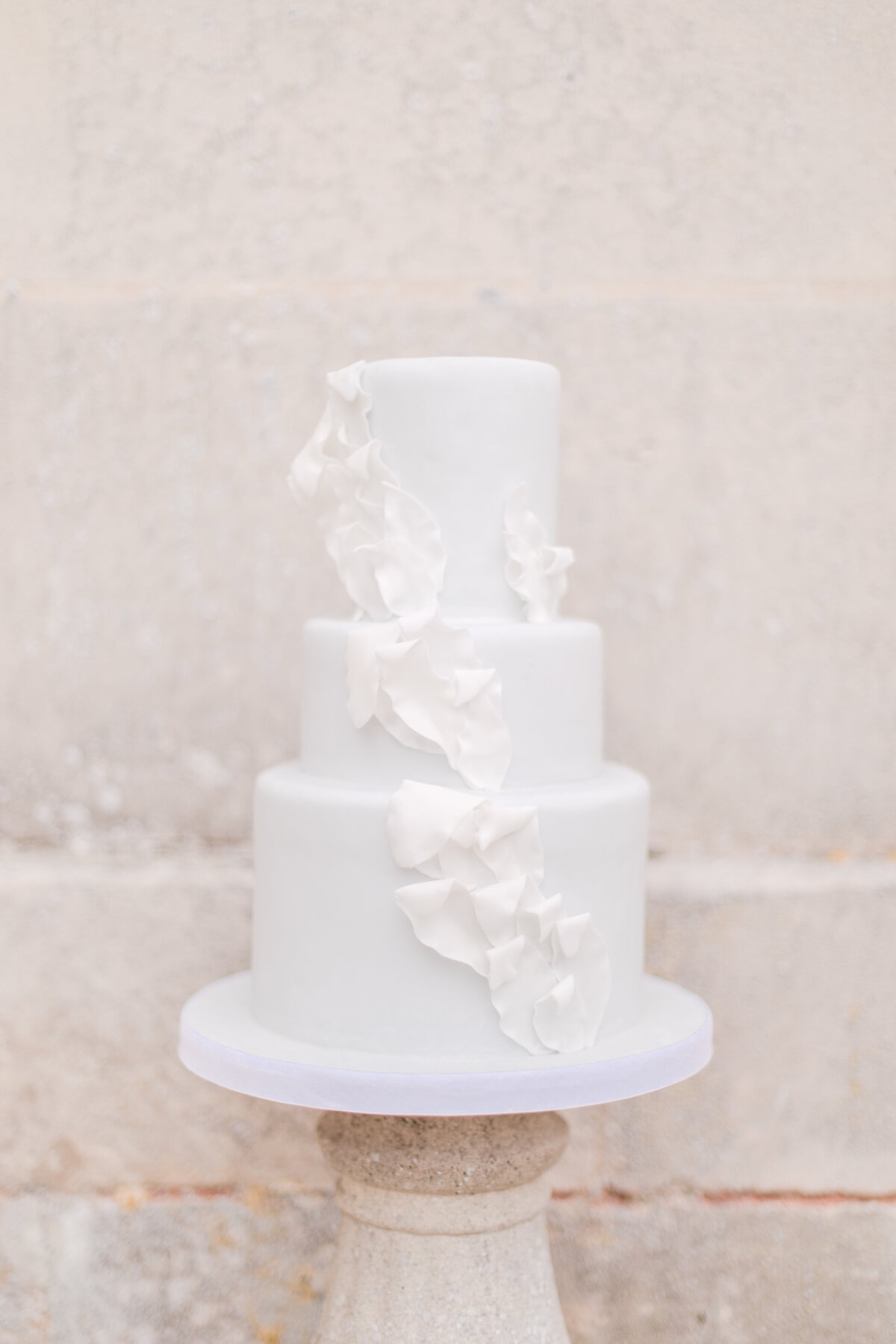 romantic all white cake with details by costola photography