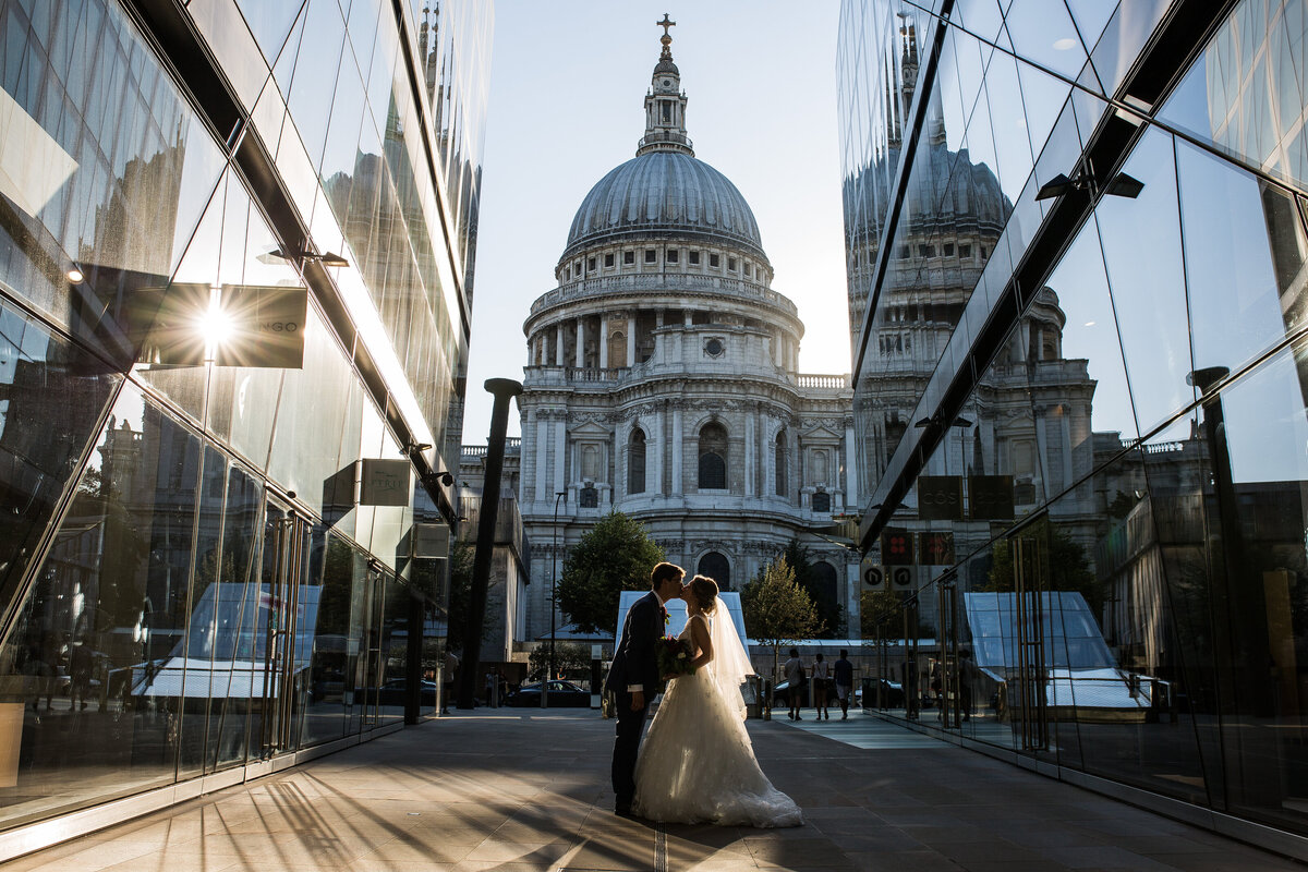 Bride and Groom Kissing by St Pauls cathedral in golden hour