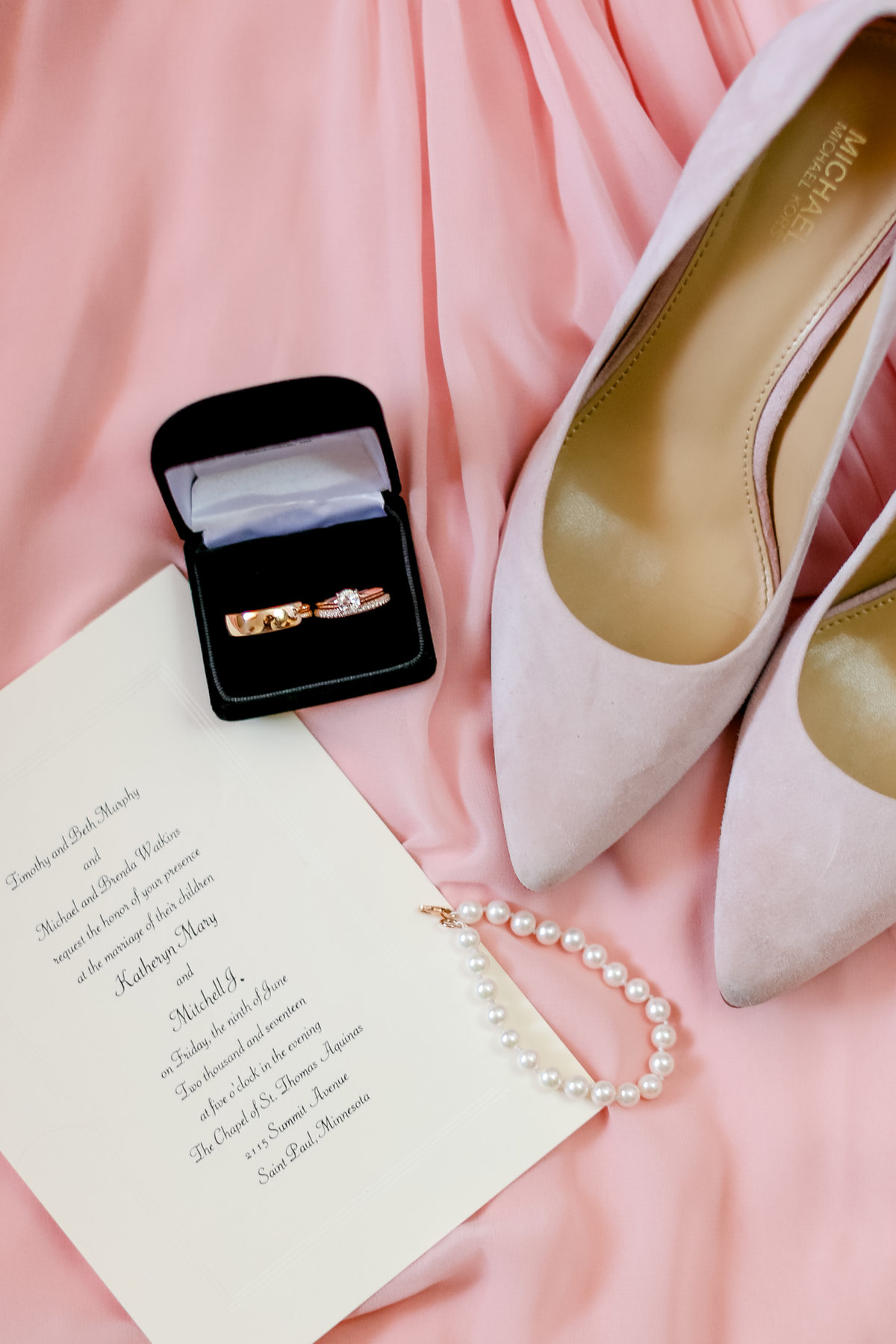 Blush wedding invite shoes and details
