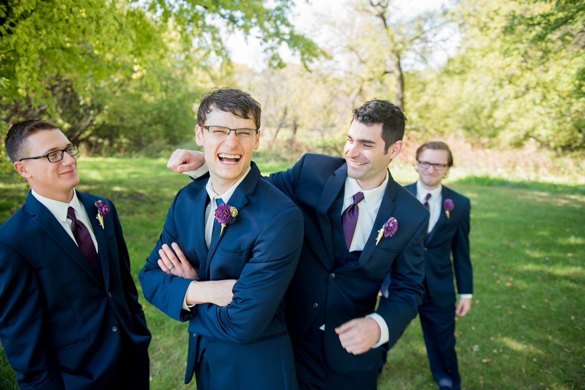 Groomsmen laughing by www.kriskandel.com