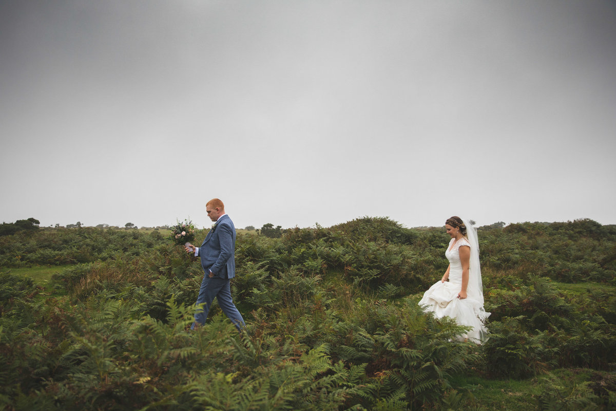 Bride and Groom walking on Bodmin Moor near The Green in Cornwall