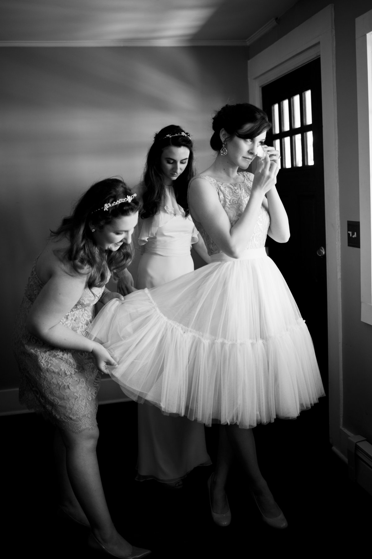 Black and White of Bride Getting Ready with Bridesmaids