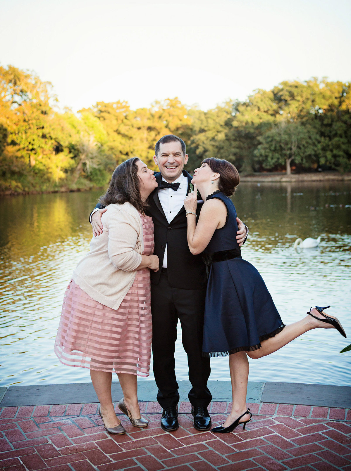 sister and mother kissing  New Orleans groom's cheek