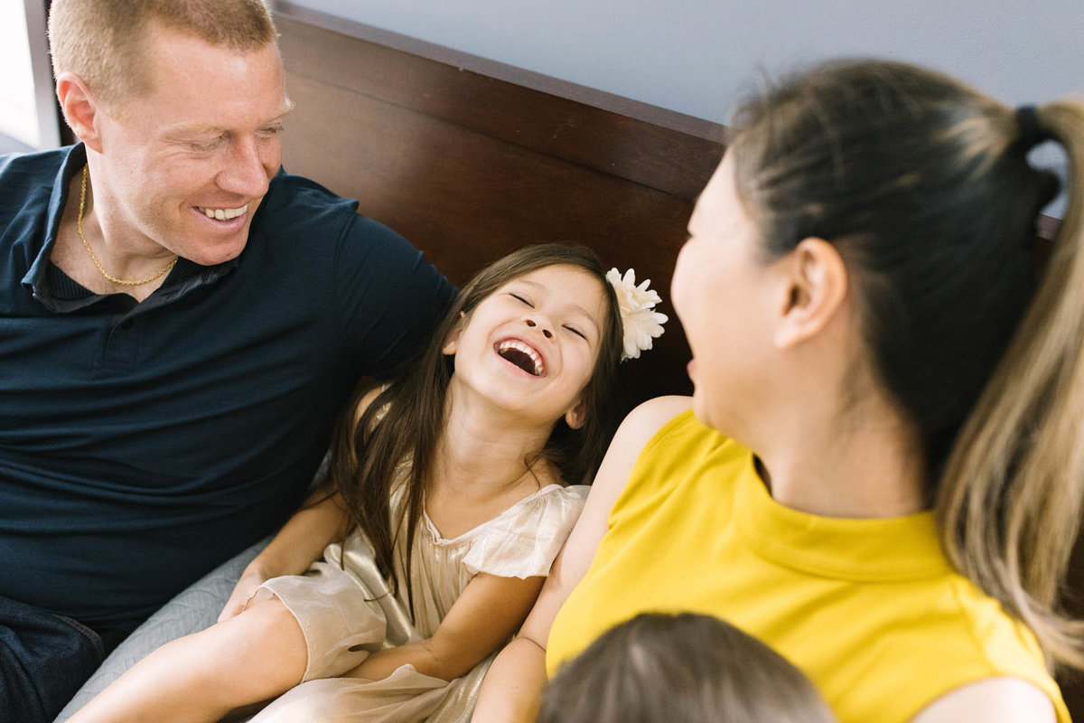 little girl laughing during family session with Chicago photographer Laurie Baker