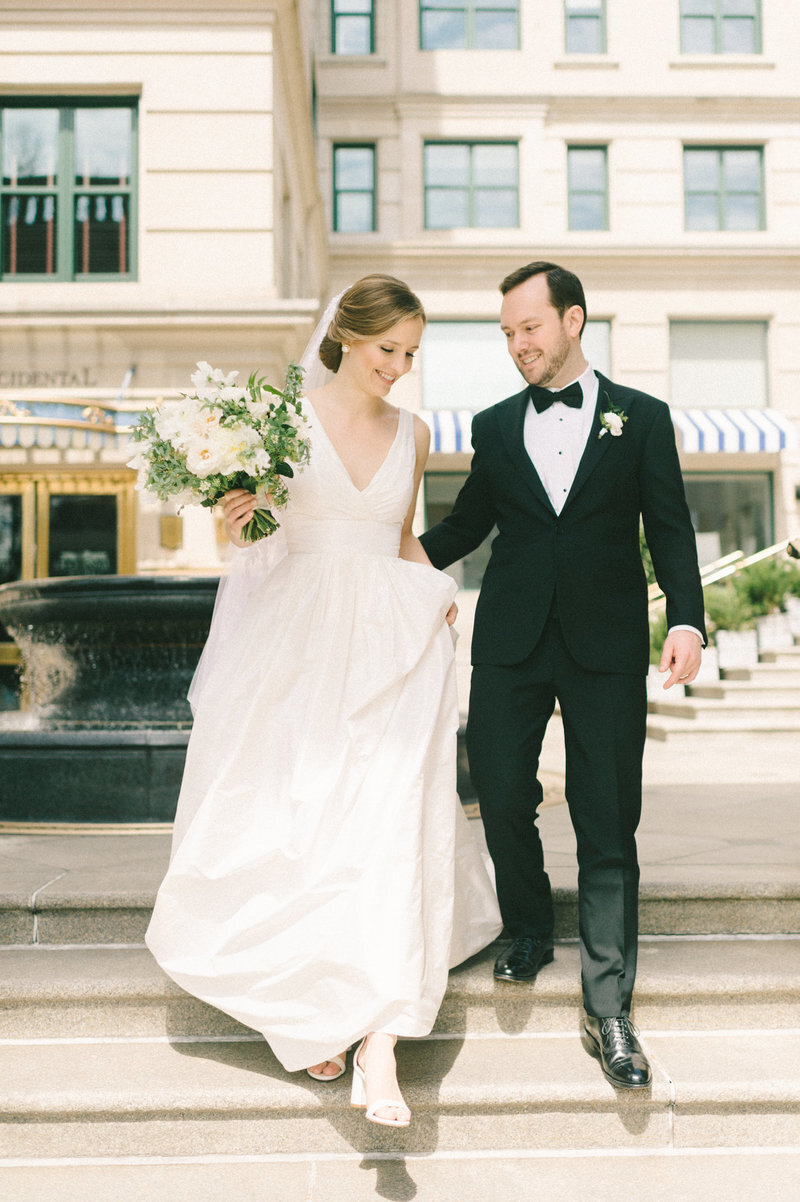 bride-groom-walking-down-stairs-the-willard-dc-liz-fogarty